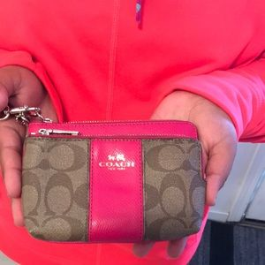 Coach Wristlet with pink detail.